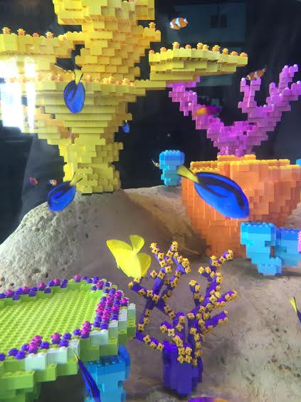 Nemo and Dory playing in their Lego home